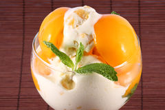 Peach Ice Cream. Peach icea cream with mint leaves Royalty Free Stock Images
