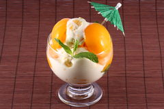 Peach Ice Cream. With mint leaves and a little umbrella Stock Photography