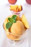 Peach ice cream. Apricot peach ice cream in glass bowl Stock Photos