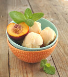 Peach ice cream in bowl Royalty Free Stock Photography