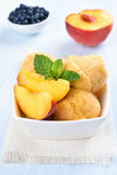 Peach ice cream. Decorated with mint, cold summer dessert Royalty Free Stock Images