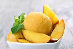 Peach ice cream with slices. Close up view Royalty Free Stock Image