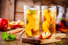 Peach ice tea in a glass with mint Stock Images