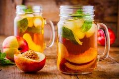 Peach ice tea in mason jar with mint Royalty Free Stock Image