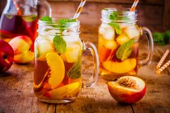 Peach ice tea in mason jar with mint Stock Photo
