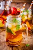 Peach ice tea in mason jar with mint Royalty Free Stock Photos