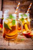 Peach ice tea in mason jar with mint Royalty Free Stock Images