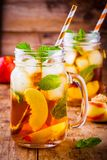 Peach ice tea in mason jar with mint Stock Image