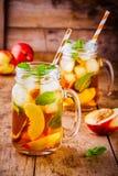 Peach ice tea in mason jar with mint Royalty Free Stock Photo