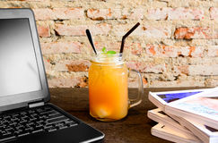 Peach ice tea on old wooden table Royalty Free Stock Photography
