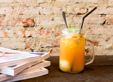 Peach ice tea on old wooden table Royalty Free Stock Photo
