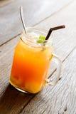 Peach ice tea on old wooden table Stock Photo