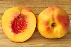 Peach. Image one half peach and one peach royalty free stock image