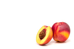 Peach isolated on white. Two peaches isolated on white, one cut in health Stock Photo