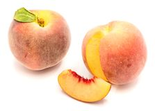 Peach isolated on white. One whole peach with green leaf, cut open, one slice, isolated on white background Stock Photo