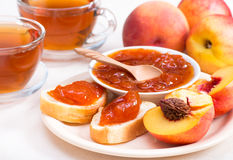 Peach jam on bread horizontal Royalty Free Stock Image