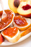 Peach jam on bread Royalty Free Stock Photo