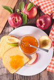 Peach jam and brioche Royalty Free Stock Images