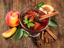 Peach jam with cinnamon sticks  and fresh peaches Stock Images
