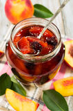 Peach jam with fresh fruits Stock Image