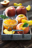 Peach jam and fresh peaches Royalty Free Stock Images