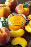Peach jam and fresh peaches Stock Photo