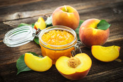 Peach jam and fresh peaches Stock Image