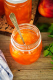 Peach Jam in a Glass Jar Stock Image
