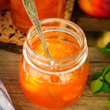 Peach Jam in a Glass Jar Stock Photography