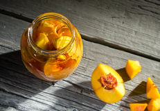 Peach jam in a glass jar Stock Images