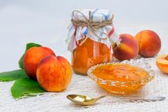 Peach jam in the jar on the table royalty free stock photos
