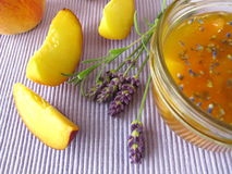 Peach jam with lavender Stock Photography
