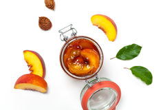 Peach Jam. Peach or Nectarine Jam on wooden background. Selective focus Royalty Free Stock Image
