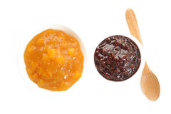 Peach jam and raspberry jam Stock Images