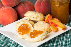 Peach jelly on biscuits Stock Photography