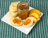 Peach jelly with biscuits and sliced peaches Royalty Free Stock Photo