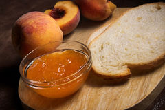 Peach jelly and bread Stock Image