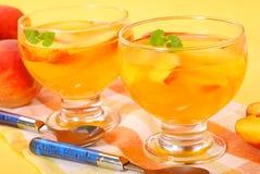 Peach jelly dessert stock photos