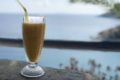 Peach Juice with aegean sea view stock photography