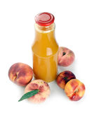 Peach juice in a bottle Royalty Free Stock Photos