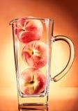 Peach juice conceptual. Peach juice unusual, in studio Stock Images
