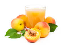 Peach juice with fresh fruits Stock Photos