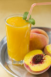 Peach juice. Fresh juice from peaches with pulp. This juice is useful to a cardiac muscle, contains potassium and vitamin A Royalty Free Stock Photography