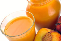 Peach juice and fruit Royalty Free Stock Photos