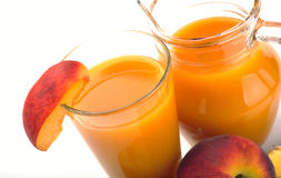 Peach juice and fruit Stock Image