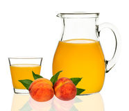 Peach juice in a glass and carafe Royalty Free Stock Photos