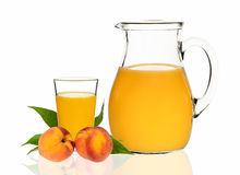 Peach juice in a glass and carafe Royalty Free Stock Photo