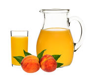 Peach juice in a glass and carafe Royalty Free Stock Photography