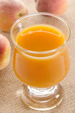 Peach juice in a glass Royalty Free Stock Photos