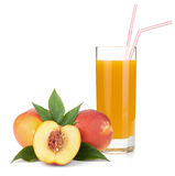 Peach juice in a glass and fresh peaches Royalty Free Stock Photo